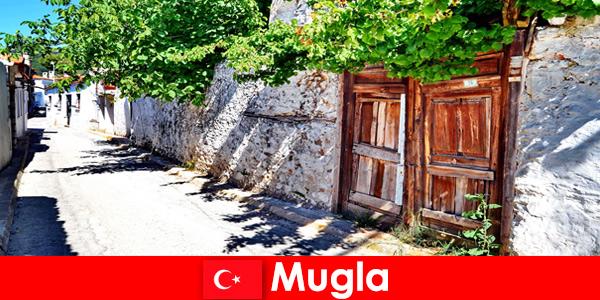 Живописные деревни и гостеприимные местные жители встречают туристов в Мугле, Турция.
